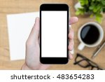 man's hand is holding a black... | Shutterstock . vector #483654283