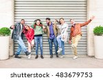 Small photo of Multiracial people with many facial expressions lined up on the street - Multiethnic friends acting funny moods in a row outdoors - Concept of different characters and uniqueness of human society