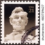 Small photo of Milan, Italy - September 11, 2016: Head of Abraham Lincoln on american postage stamp