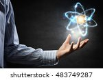 atom icon in palm . mixed media | Shutterstock . vector #483749287