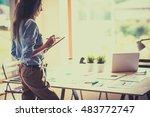young woman standing near desk... | Shutterstock . vector #483772747