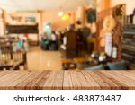 wood table with restaurant blur ... | Shutterstock . vector #483873487