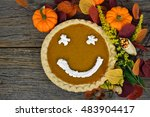 Pumpkin Pie With Happy Face In...