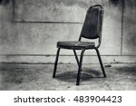 Small photo of Old chair in a dim light in the night of Halloween., add grain filter or noise affect for dirty and scary thoughts concept or dark feelings