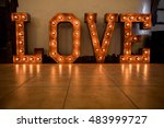 wooden letters with bulb lights.... | Shutterstock . vector #483999727