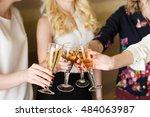 hands holding the glasses of... | Shutterstock . vector #484063987