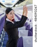 Small photo of a beautiful asia lady that she work as air hostess prepare in flight service for serving passenger in the aircraft