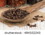spice cloves in a wooden spoon...   Shutterstock . vector #484102243