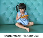 Child Girl Using Smart Phone O...
