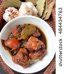 Small photo of Paksiw na Pata - Famous Filipino cuisine, Braised Pork Adobo.pork cooked in soy sauce, vinegar, garlic, ginger and bay leaves