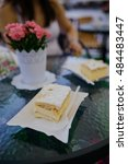 Small photo of piece of fondant cake on table, outdoor restaurant