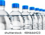 Row Of Plastic Bottles With...
