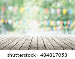 empty wooden table with party... | Shutterstock . vector #484817053