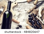 setting with bottle of red wine ... | Shutterstock . vector #484820647