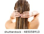 woman applying hair conditioner.... | Shutterstock . vector #485058913