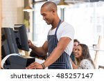 happy young waiter in blue... | Shutterstock . vector #485257147