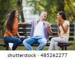 three friends are sitting on... | Shutterstock . vector #485262277
