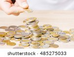 man stacking coins on table   Shutterstock . vector #485275033