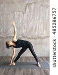 woman practicing yoga in... | Shutterstock . vector #485286757