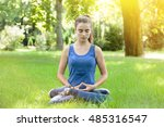 Meditating Teenage Girl In A...