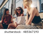 three young women meeting at... | Shutterstock . vector #485367193