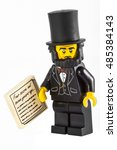 Small photo of LONDON, UK - OCTOBER 15TH 2015: A Lego minifigure toy of Abraham Lincoln holding his Gettysburg Address speech, on 15th October 2015.