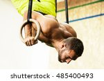 young fit man pulling up on... | Shutterstock . vector #485400493