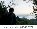 sunset and a silhouette tourist ... | Shutterstock . vector #485402677