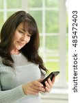 senior woman talking phone   Shutterstock . vector #485472403