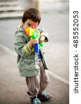 Child Aiming Toy Rifle. Ready...