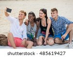 four young cheerful people... | Shutterstock . vector #485619427