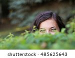 shy glance from a woman behind... | Shutterstock . vector #485625643