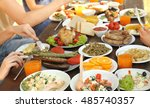 friends eating on picnic | Shutterstock . vector #485740357