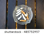 Small photo of Cigarette butts and ashtrays on the table. Tobacco is a drug that causes adverse effects on the body such as Pulmonary Emphysema