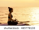 asia woman yoga on the beach at ... | Shutterstock . vector #485778133