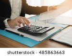 accountant using a calculator... | Shutterstock . vector #485863663