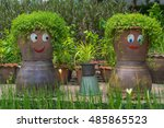 smiling funny flower pots in a... | Shutterstock . vector #485865523