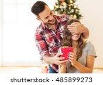 man giving a christmas present... | Shutterstock . vector #485899273