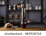 Small photo of aero press coffee preparation Aeropress mounted on transparent whiskey rox glass Professional coffee brewing cafe shop