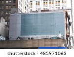 Small photo of Side of a building in New York with painted-over advert space