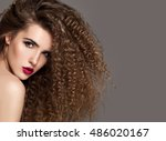 beauty young woman with curly... | Shutterstock . vector #486020167