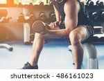 man using dumbbell in public... | Shutterstock . vector #486161023