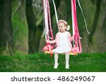 little girl on the swing ... | Shutterstock . vector #486249067