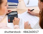 two female accountants counting ... | Shutterstock . vector #486260017