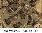 old gears in black oil. sandy... | Shutterstock . vector #486305317