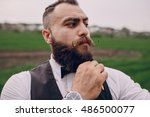 man care his beard | Shutterstock . vector #486500077