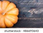 Pumpkin On Old Rustic Wooden...