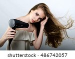 the girl plays with the hair... | Shutterstock . vector #486742057