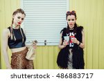 young women drinking from a... | Shutterstock . vector #486883717
