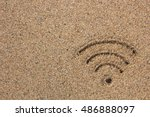 wi fi sign drawn in the sand